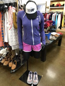 Mannequin with purple jackets and pink short displayed inside Goodwill Store & Donation Center