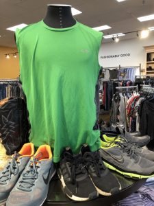 Mannequin with green vest displayed inside Goodwill Store & Donation Center