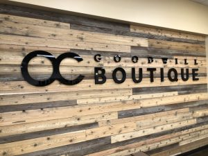 OC Goodwil Boutique signage displayed inside Goodwill Store & Donation Center