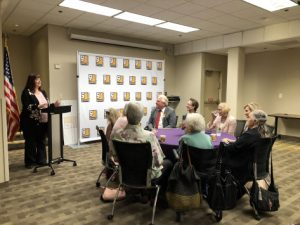 A lady's speech at Goodwill of Orange County and a group of people listening