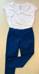 White top with blue trousers
