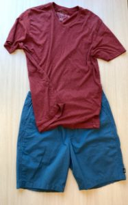 Solid blue shorts with a simple red V-neck or crew t-shirt.