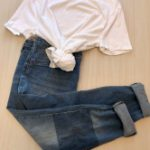 Plain white crew neck tee with blue jeans