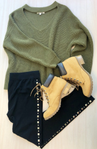 Over sized olive chunky sweater with leggings and boots.