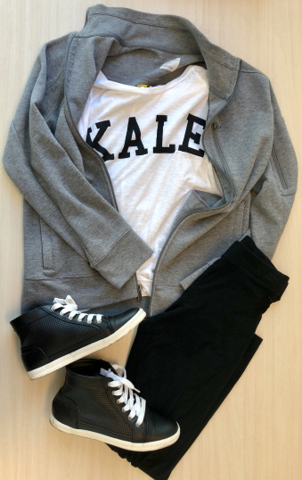 White t-shirt with text that reads kale on the front, Grey jacket, black leggings, and black shoes
