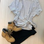 Striped white top and black leggings with boots