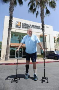 Bill Calliham in front of  Goodwill of Orange County's Rogers A. Severson Fitness & Technology Center