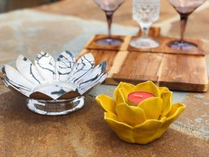 Yellow and chrome Flower Decor with three mini glass cups in a wooden board.