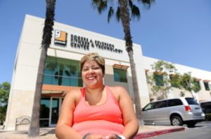 Devina Robias poses outside Goodwill of Orange County's Rogers A. Severson Fitness & Technology Center