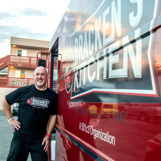 Bill standing next to his mobile food truck