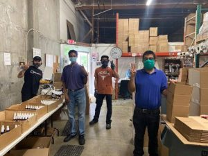 Four workers wearing masks at CareCo