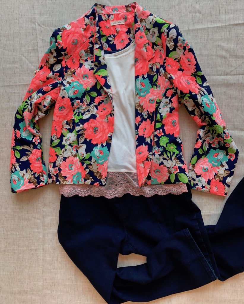 Neon fun blazer paired with a simple camisole and jeans