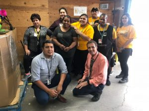 Employees at Goodwill of Orange County poses as they celebrate Goodwill Industries Week.