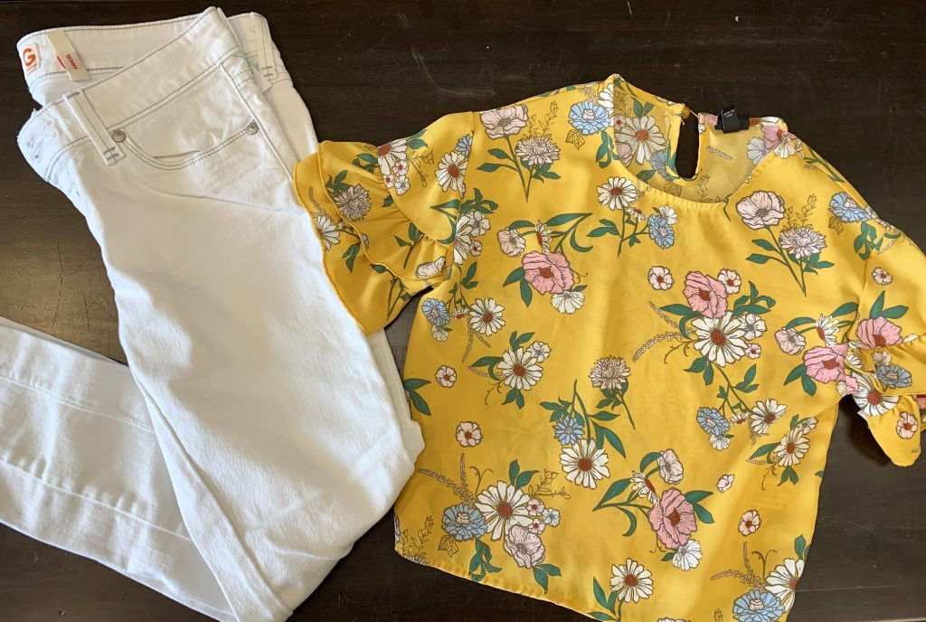 Floral blouse and white jeans